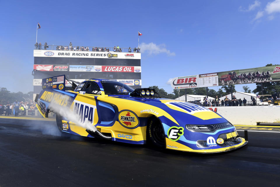 In this photo provided by the NHRA, Funny Car driver Ron Capps competes in the Lucas Oil NHRA Nationals at Brainerd International Raceway in Brainerd, Minn., Sunday, Aug. 18, 2019. Capps earned his sixth victory at the speedway over his Don Schumacher Racing teammate Tommy Johnson Jr. in the final round with his 3.946-second lap at 324.28 mph. (Marc Gewertz/NHRA via AP)