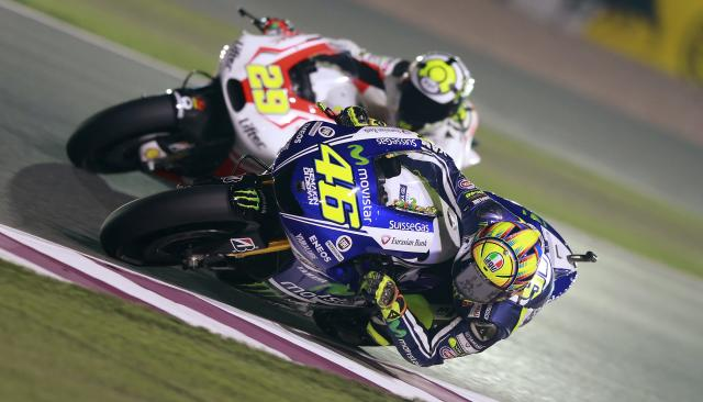 Yamaha MotoGP rider Valentino Rossi of Italy rides his bike during a free practice session at the MotoGP World Championship at the Losail International circuit in Doha March 21, 2014. REUTERS/Mohammed Dabbous (QATAR - Tags: SPORT MOTORSPORT)