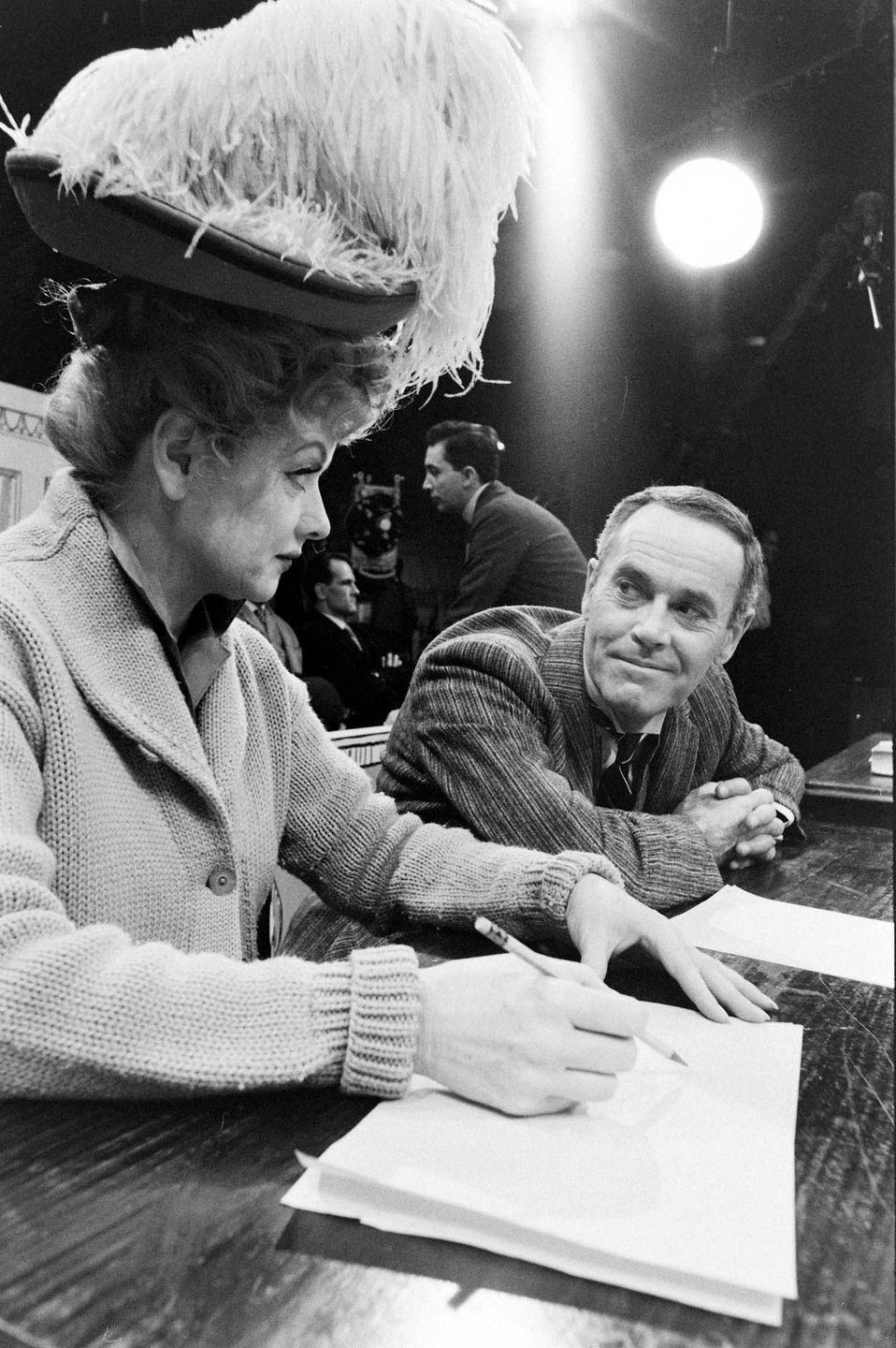 <p>In 1962, Lucille premiered her TV special, <em>The Good Years</em>. Here, she wears a vintage hat, while running lines with her costar, Henry Fonda. </p>