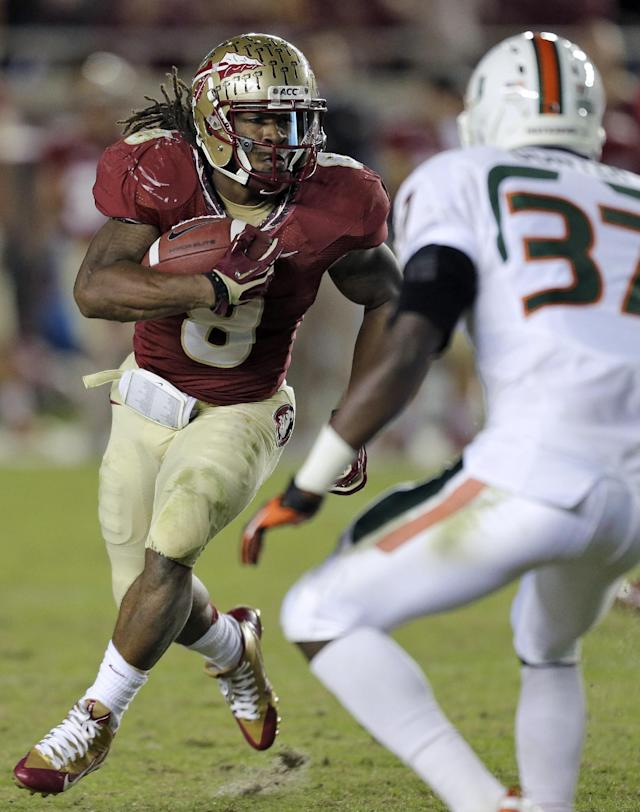 Florida State running back Devonta Freeman (8) runs towards Miami defensive back Ladarius Gunter (37) during the third quarter of an NCAA college football game Saturday, Nov. 2, 2013, in Tallahassee, Fla. (AP Photo/Chris O'Meara)
