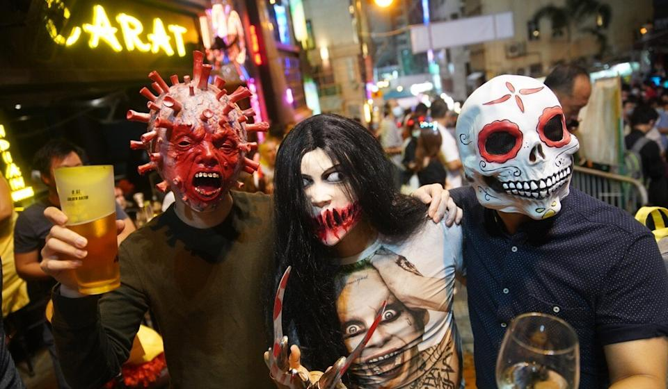 Keeping masks on was easy for some party-goers in Lan Kwai Fong. Photo: Winson Wong