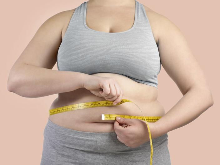 Obese people may have dangerous amounts of fat in their lungs. [Photo: Getty]