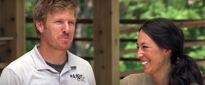 Joanna Gaines laughs at her husband Chip.
