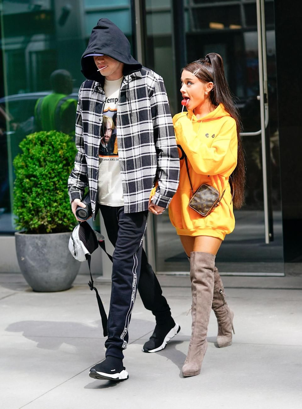 If Grande didn't invent the oversized hoodie and knee-high boot combo she's definitely its biggest celebrity ambassador. The outfit alone is a cute everyday look, but it's the lollipop in sleeve-covered hand while suggestively gazing at ex- Pete Davidson that make this image one for the books.