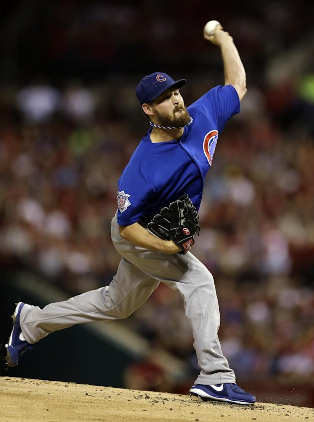 Chicago Cubs starting pitcher Travis Wood throws during the first inning of a baseball game against the St. Louis Cardinals Friday, Sept. 27, 2013, in St. Louis. (AP Photo/Jeff Roberson)