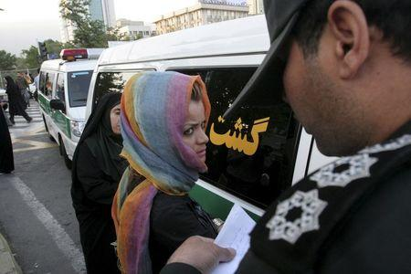 "File photo shows morality police taking down the name of a detained woman during a crackdown on ""social corruption"" in north Tehran"