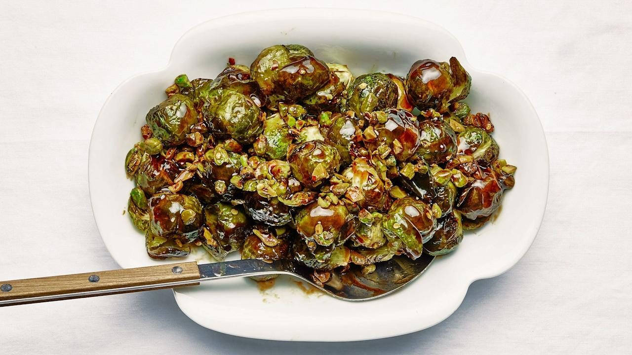"""These roasted whole brussels sprouts get so crispy on the outside you'll worry they're burnt (they're not!). Inside though, they're perfectly, deliciously mushy—which, according to us, isn't a bad thing. Of course, it gets even better when you coat them in a date molasses–brown butter glaze. Typically made from dates and nothing else, date molasses has a thick consistency and brings a deep, fruity sweetness and a bit of tartness. The Test Kitchen likes <a href=""""https://www.amazon.com/Al-Wadi-Molasses-24-7-Ounce-Natural/dp/B075RDTJD7/"""">Al Wadi Al Akhdar brand</a> or <a href=""""https://www.amazon.com/Just-Date-Syrup-Glycemic-Gluten-free/dp/B07G5KMT5N/"""">Just Date Syrup</a>. See all of the <a href=""""https://bonappetit.com/gallery/absolutely-perfect-thanksgiving-menu"""">Absolutely</a><a href=""""https://bonappetit.com/gallery/making-perfect-thanksgiving-menu"""">, Positively Perfect Thanksgiving recipes here</a>. <a href=""""https://www.bonappetit.com/recipe/brussels-sprouts-with-pistachios-and-lime?mbid=synd_yahoo_rss"""">See recipe.</a>"""
