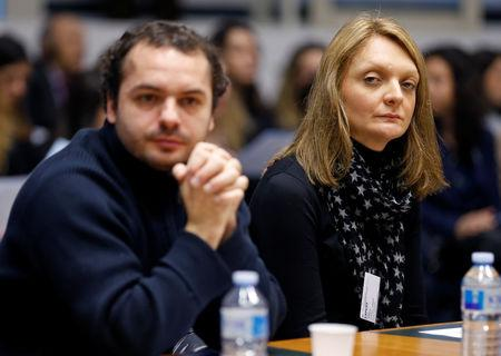 FILE PHOTO: Rachel Lambert (R), the wife of Vincent Lambert, sits besides her nephew Francois Lambert, as they wait for the start of an hearing concerning the case of her husband at the European Court of Human Rights in Strasbourg, January 7, 2015. REUTERS/Vincent Kessler/File Photo