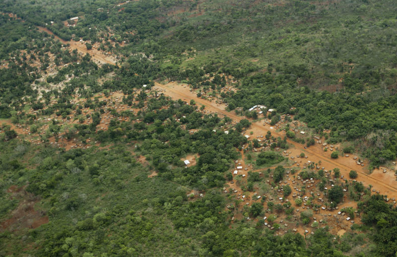 """FILE - In this Sunday, April 29, 2012 file photo, the town of Obo, where U.S. special forces have paired up with local troops and Ugandan soldiers to seek out Joseph Kony's Lord's Resistance Army (LRA), is seen from the air in the Central African Republic. The U.S.-based Enough Project advocacy group said in a report released Friday, Nov. 9, 2012 that the hunt for the African warlord Joseph Kony is hopeless without more troops and urges American forces to """"play a more operational role"""" on the ground. (AP Photo/Ben Curtis, File)"""