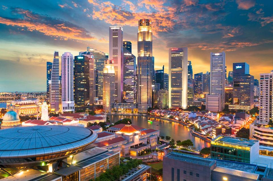 "<p>Nicknamed the Lion City, Singapore mixes contemporary architecture with timeless traditions to create a city like no other in Asia. The extravagant glass greenhouses of Gardens of the Bay welcome guests to stroll across the sprawling conservatory known for its tulip and orchid exhibits. </p><p>Foodies will never go hungry with nearly 218 hawker centers serving up Michelin-rated meals for low prices. We also recommend stopping through the Katong area of the city where <a href=""https://www.veranda.com/travel/g33337870/most-colorful-places-in-the-world/"" rel=""nofollow noopener"" target=""_blank"" data-ylk=""slk:candy-colored houses"" class=""link rapid-noclick-resp"">candy-colored houses</a> retell the history of the Peranakan people.</p>"