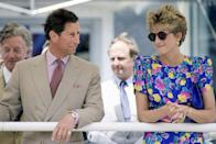 <p>A younger Charles wore the ring with a matching gold watch, while Princess Diana sported her trusty watch and hoop combo while the couple were in Seville, Spain in May 1992. </p>
