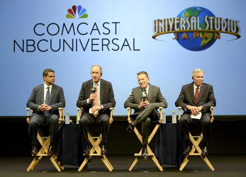 Comcast Corp. Chairman and CEO Brian Roberts, Universal Studios Japan Chairman and CEO Glenn Gumpel, and unidentified officials attend their joint news conference in Osaka, western Japan