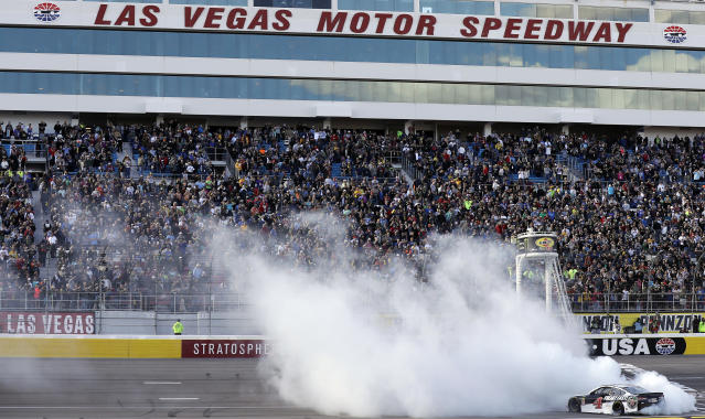 "<a class=""link rapid-noclick-resp"" href=""/nascar/sprint/drivers/205/"" data-ylk=""slk:Kevin Harvick"">Kevin Harvick</a> performs a burnout after winning a NASCAR Cup series auto race Sunday, March 4, 2018, in Las Vegas. (AP Photo/Isaac Brekken)"