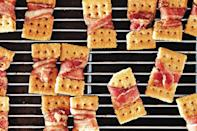 """Crackers with a bacon belt are the kind of craveable, <a href=""""https://www.epicurious.com/recipes-menus/elegant-one-bite-hors-d-oeuvres-gallery?mbid=synd_yahoo_rss"""" rel=""""nofollow noopener"""" target=""""_blank"""" data-ylk=""""slk:snackable appetizer"""" class=""""link rapid-noclick-resp"""">snackable appetizer</a> anyone in the kitchen can help assemble. And they'll probably be the most talked about item on the menu. <a href=""""https://www.epicurious.com/recipes/food/views/bacon-crackers-classic-herbed-and-brown-sugar?mbid=synd_yahoo_rss"""" rel=""""nofollow noopener"""" target=""""_blank"""" data-ylk=""""slk:See recipe."""" class=""""link rapid-noclick-resp"""">See recipe.</a>"""