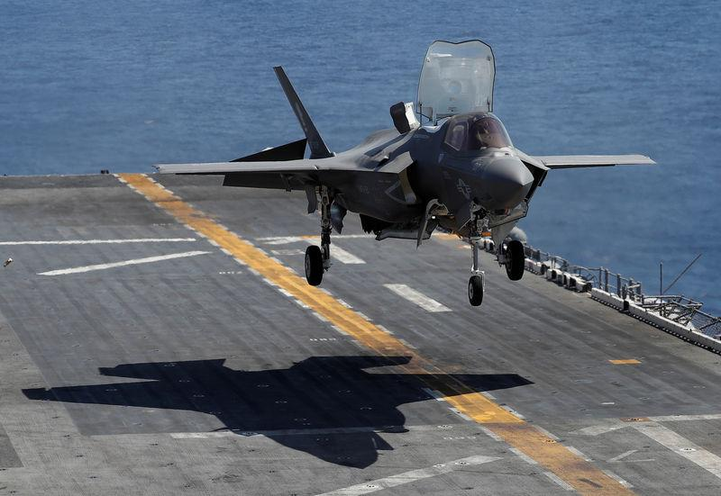 A Marine Corps pilot prepares for a vertical landing of Lockheed Martin F-35B stealth fighter aboard the USS Wasp amphibious assault carrier off Japan's southernmost island of Okinawa, Japan