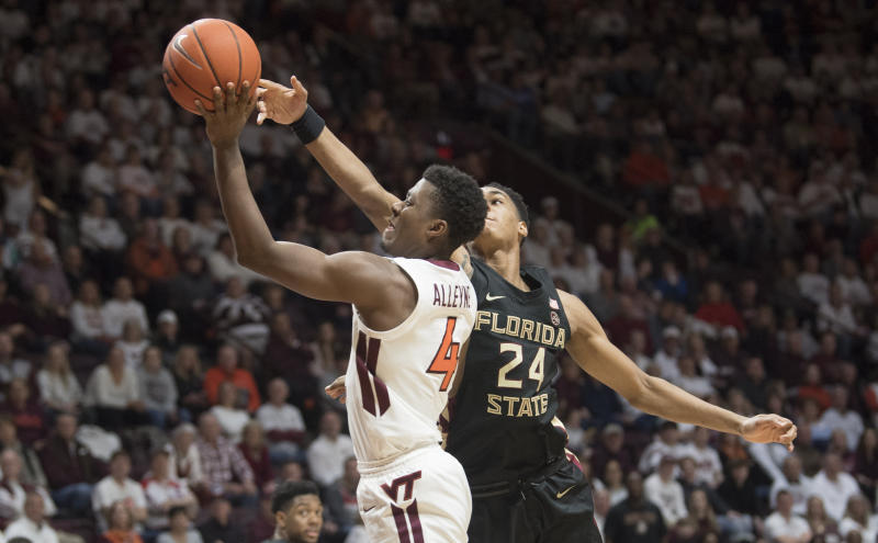 Virginia Tech guard Nahiem Alleyne (4) drives to basket as Florida State guard Devin Vassell (24) defends during the second half of an NCAA college basketball game in Blacksburg, Va., Saturday, Feb. 1, 2020. (AP Photo/Lee Luther Jr.)