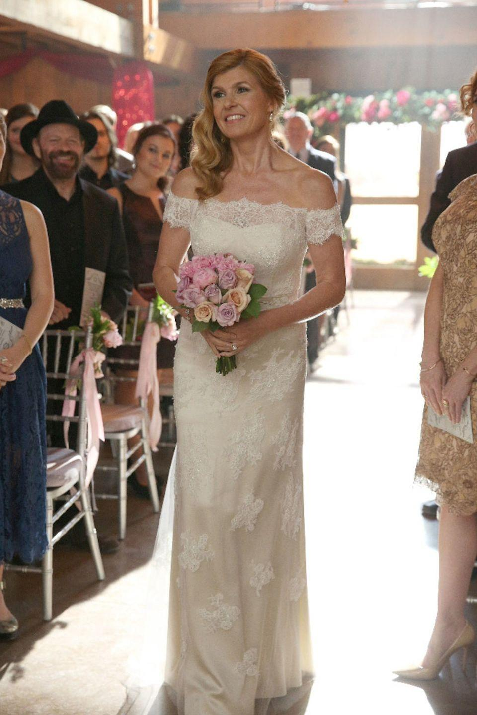 <p>In season 4, Rayna James exchanged vows with Deacon Claybourne wearing an off-the-shoulder wedding dress with lace and had her hair swept to one side. </p>