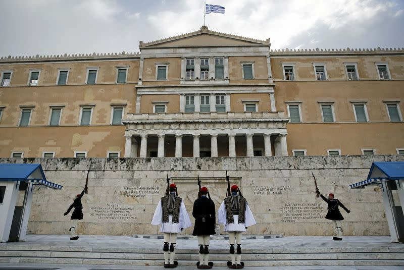 Greek Presidential guards perform during a change of shift at the Tomb of the Unknown Soldier in Athens