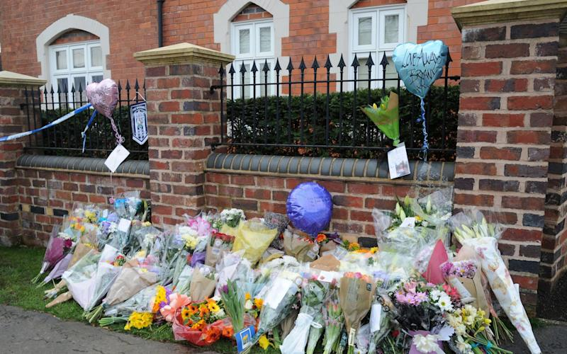 Flower tributes outside the Wilkinson's family home in Stourbridge, West Midlands - Credit: PA
