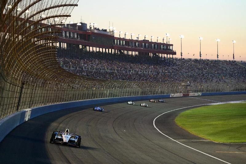 Australia's Will Power leads a pack of cars during the IndyCar World Championship Race on August 30, 2014 in Fontana, California