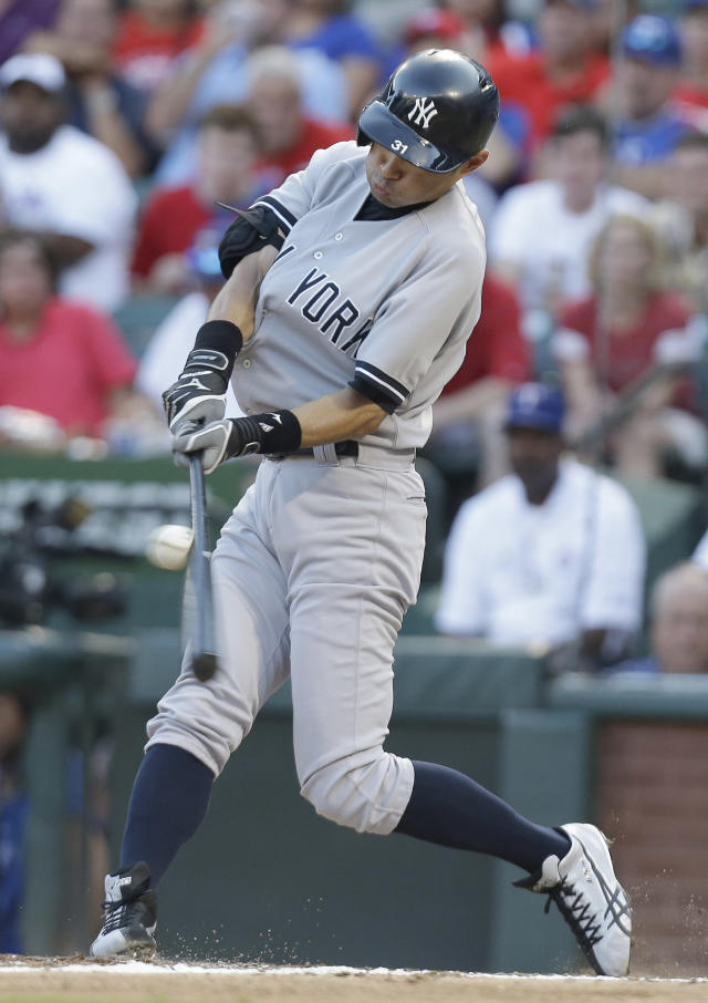 New York Yankees' Ichiro Suzuki, of Japan, hits an RBI single during the third inning of a baseball game against the Texas Rangers Tuesday, July 23, 2013, in Arlington, Texas. Yankees Austin Romine scored on the play (AP Photo/LM Otero)