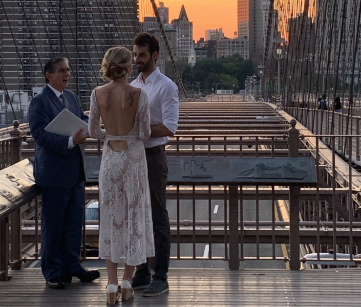 A woman tracked down a newlywed couple on social media after taking the only photo of their intimate ceremony. (Photo: Twitter)