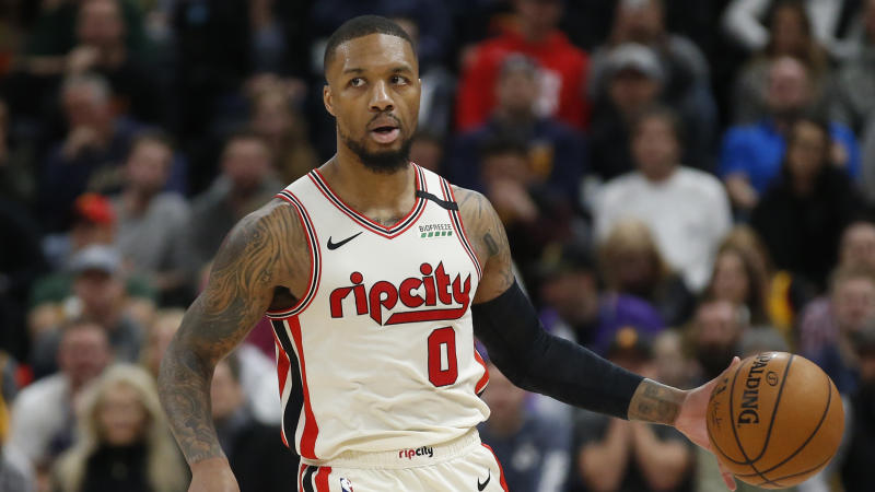 "Despite Portland's ""no"" vote, the NBA's plan should quell any concern about Damian Lillard playing. (AP Photo/Rick Bowmer)"