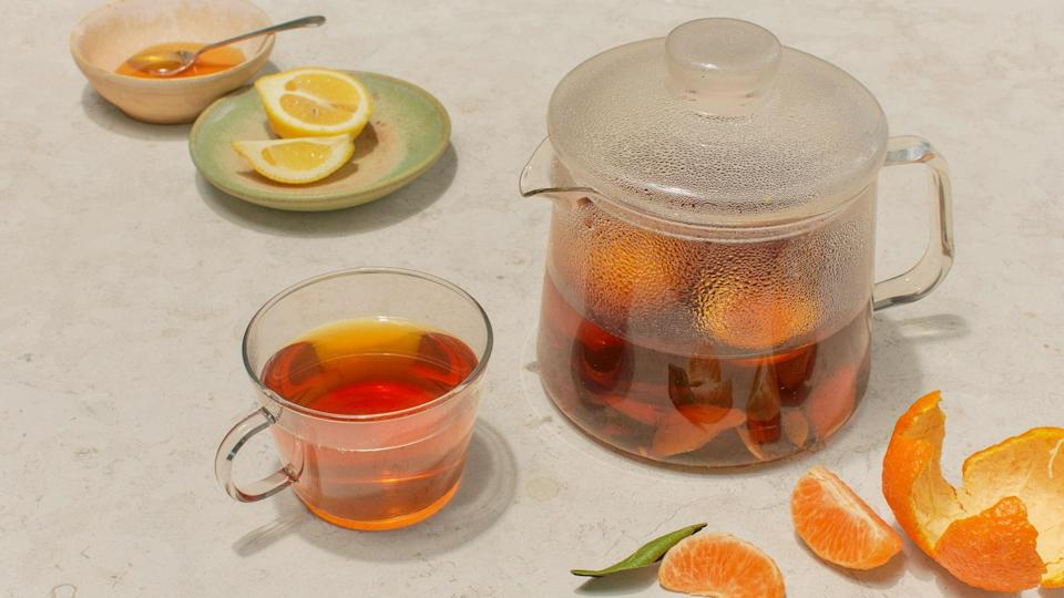 """This tea combines warming spices with the bright, bitter flavor of orange peels. Perfect for sick days, the recipe is totally adaptable—add cloves or fennel seeds, or stir in ground spices at the end. And if you like your drinks on the savory side, try adding ¼ tsp. smoky black cardamom. –<strong>Sonia Chopra</strong>, <em>executive editor</em> <a href=""""https://www.bonappetit.com/recipe/orange-peel-chai?mbid=synd_yahoo_rss"""" rel=""""nofollow noopener"""" target=""""_blank"""" data-ylk=""""slk:See recipe."""" class=""""link rapid-noclick-resp"""">See recipe.</a>"""