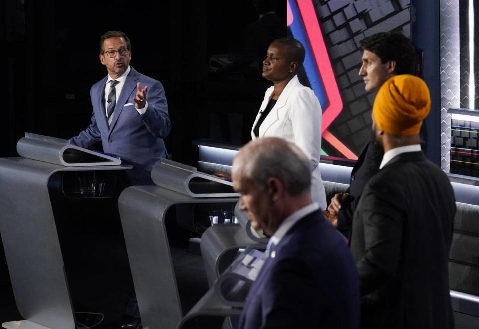 """<span class=""""caption"""">The five party leaders square off in the English-language debate in Gatineau, Que. </span> <span class=""""attribution""""><span class=""""source"""">THE CANADIAN PRESS/Adrian Wyld </span></span>"""
