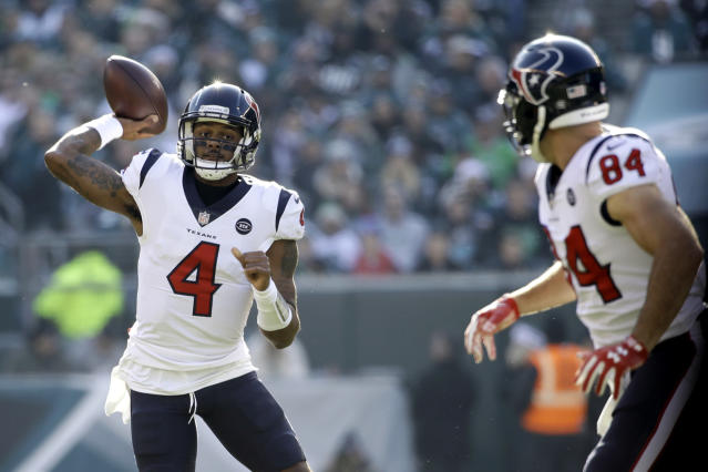 Houston Texans' Deshaun Watson (4) passes as Ryan Griffin (84) looks on during the first half of an NFL football game against the Philadelphia Eagles, Sunday, Dec. 23, 2018, in Philadelphia. (AP Photo/Matt Rourke)