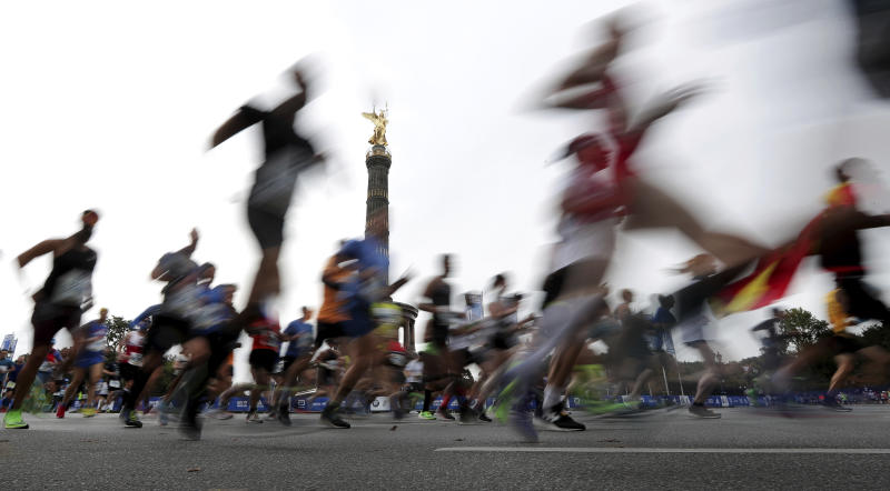 Runners pass by the 'Victory Column' as they start for the 46th Berlin Marathon in Berlin, Germany, Sunday, Sept. 29, 2019. (AP Photo/Michael Sohn)