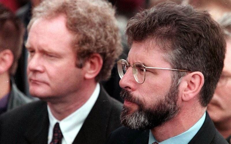 Martin McGuinness, left, and Gerry Adams attend a funeral after the Omagh bombing in 1998 - Credit: PA