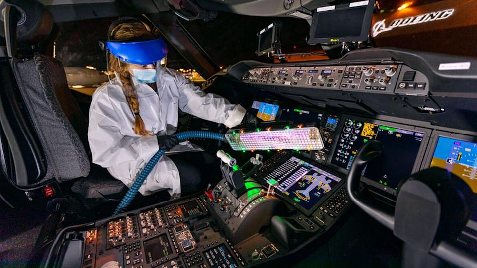 A worker using Boeing's 'UV wand'