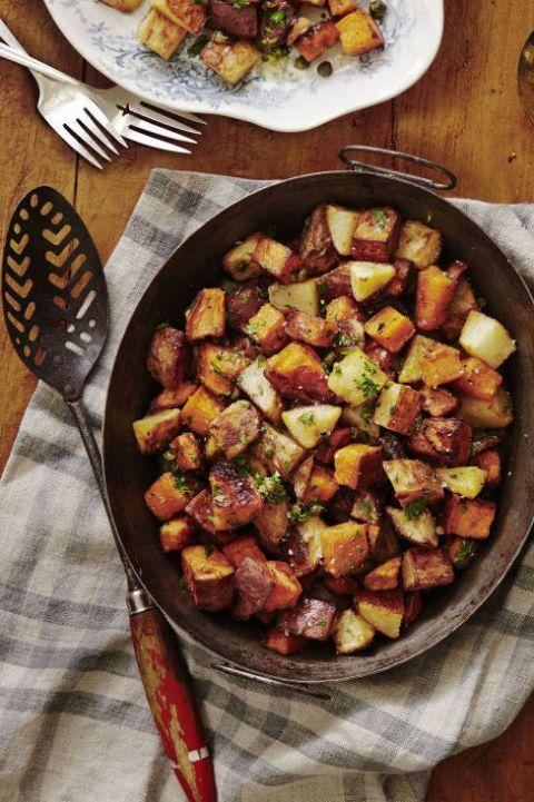 """<p>We don't give side dishes enough credit. While the main dish gets all of the attention, everyone will be asking for second helpings of these crispy potatoes.</p><p><em><a href=""""https://www.goodhousekeeping.com/food-recipes/easy/a34573/crispy-roasted-potatoes-with-caper-vinaigrette/"""" rel=""""nofollow noopener"""" target=""""_blank"""" data-ylk=""""slk:Get the recipe for Crispy Roasted Potatoes with Caper Vinaigrette »"""" class=""""link rapid-noclick-resp"""">Get the recipe for Crispy Roasted Potatoes with Caper Vinaigrette »</a></em></p>"""