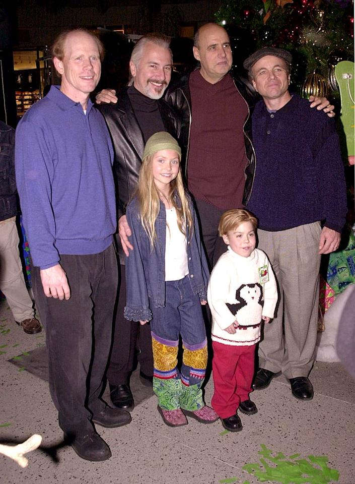 """November 2001: Posing with members of her """"Grinch"""" cast and crew including (from left to right) Ron Howard, Rick Baker, Jeffrey Tambor, Clint Howard and Josh Ryan Evans, 8-year-old Taylor went for the Texas tuxedo look with this denim-on-denim ensemble. We're not sure what's up with the bottom half of those jeans, but we're sure that Blair Waldorf would not approve!   <a href=""""http://www.seventeen.com/fashion/tips/style-stars-quotes-2010?link=rel&dom=yah_omg&src=syn&con=art&mag=svn"""" target=""""new"""">Get Style Secrets from Taylor Swift, Rihanna, and More</a> Mike Guastella/<a href=""""http://www.wireimage.com"""" target=""""new"""">WireImage.com</a> - November 20, 2001"""