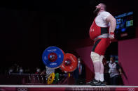 Lasha Talakhadze of Georgia celebrates after winning gold in the men's +109kg weightlifting event, at the 2020 Summer Olympics, Wednesday, Aug. 4, 2021, in Tokyo, Japan. (AP Photo/Seth Wenig)