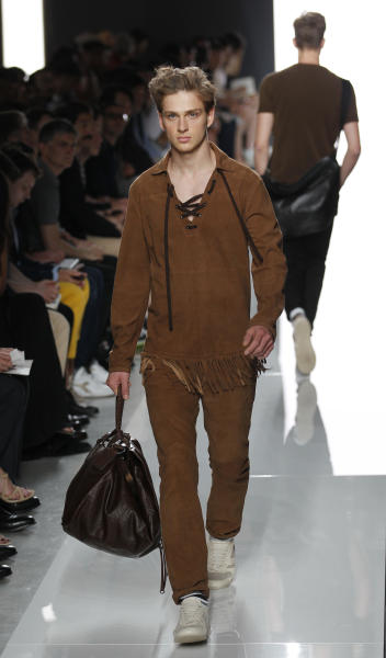 A model wears a creation of Bottega Veneta from the men's Spring-Summer 2013 collection as part of the Milan Fashion Week in Milan, Italy, Sunday, June 24, 2012. (AP Photo/Luca Bruno)