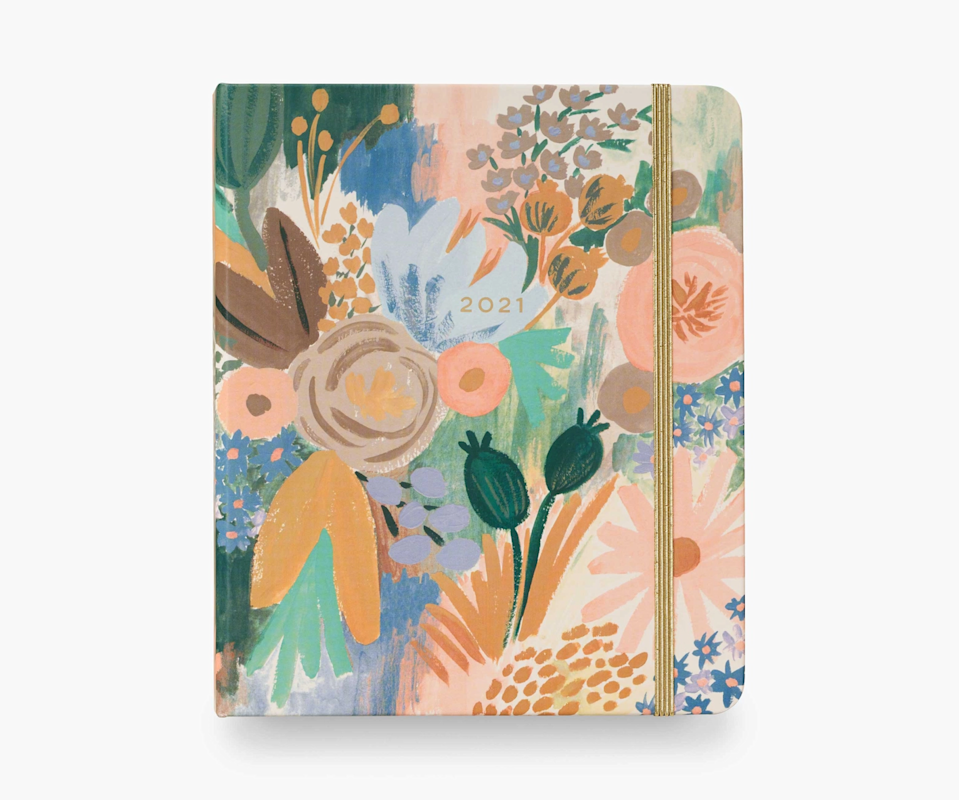 """<h3><a href=""""https://riflepaperco.com/2021-wild-garden-17-month-planner"""" rel=""""nofollow noopener"""" target=""""_blank"""" data-ylk=""""slk:Rifle Paper Co. 17-Month Planner"""" class=""""link rapid-noclick-resp"""">Rifle Paper Co. 17-Month Planner</a></h3><br><strong>Deal: Up to 20% off on select 2021 planners</strong><br><br>No surprise here, Rifle Paper Co.'s 17-month hardcover planners feature a variety of their standout illustrations. This one includes weekly and monthly pages, sections for celebrations, notes, and contacts, 3 sticker pages, and a pocket with a ruler. <br><br><br><br><strong>Rifle Paper Co</strong> 2021 17-Month Planner, $, available at <a href=""""https://go.skimresources.com/?id=30283X879131&url=https%3A%2F%2Friflepaperco.com%2F2021-luisa-17-month-planner"""" rel=""""nofollow noopener"""" target=""""_blank"""" data-ylk=""""slk:Rifle Paper Co"""" class=""""link rapid-noclick-resp"""">Rifle Paper Co</a>"""