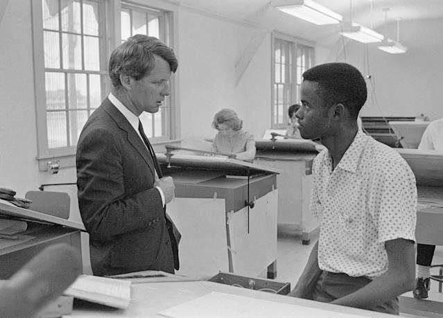 <p>Kennedy talks with a student at the Manpower Development and Training Center at Greenville, Miss., April 12, 1967. (Photo: Jack Thornell/AP) </p>