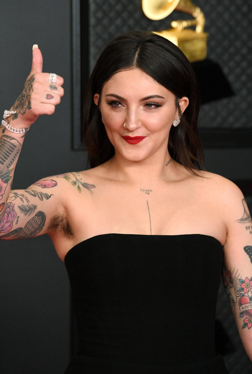 """<p>Michaels lives very much so by the """"you do you"""" philosophy, even if a majority of the world does not. Back in May of 2020 when she said """"social norms can eat an eggplant"""" and decided to <a href=""""https://www.popsugar.com/beauty/celebrities-normalizing-body-hair-47942188"""" class=""""link rapid-noclick-resp"""" rel=""""nofollow noopener"""" target=""""_blank"""" data-ylk=""""slk:stop shaving her armpits"""">stop shaving her armpits</a>, people had a lot to say about it - and they still do, but she doesn't let it bother her. </p> <p>""""I had taken a trip with some of my friends and [my underarm hair] had started to grow out and when I shaved it, I didn't feel like myself; it was really strange,"""" said Michaels. After talking to her boyfriend about it, she decided to stop shaving the hair altogether and has stuck with it ever since. """"I was like, so long as my boyfriend still wants to f*ck me, I'm cool,"""" she said.</p> <div class=""""pullquote-container""""><blockquote class=""""pullquote"""">There's something really liberating about doing the things that people tell you not to do. If it's something as simple as growing my armpit hair out, I'm down for it.</blockquote></div> <p>The reason anyone decides to remove or not to remove their body hair is a personal choice, but for Michaels it's partially about just doing whatever feels right and partially about sticking it to haters. """"There's something really liberating about doing the things that people tell you not to do and I get a kick out of that,"""" she said. """"If it's something as simple as growing my armpit hair out, I'm down for it. You'd be surprised at how many men comment on my social media still being like 'That's disgusting. You should shave it,' and it's like, why do you feel like you can comment on my body?""""</p>"""