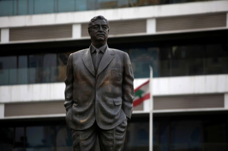 FILE PHOTO: A statue of Lebanon's assassinated former prime minister Rafik al-Hariri is seen near the site of the suicide truck bombing that killed him in 2005, in Beirut