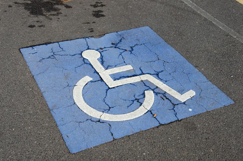 Pictured is a wheelchair disabled symbol in a car park.