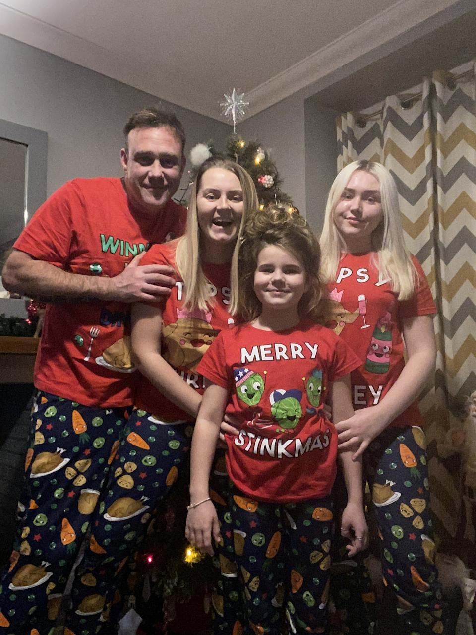 The family found solace in the twinkly tree-lights which brightened up their evenings and gave hope, pictured with her partner Shayne and children, Demi, and Kayleigh, right.  (SWNS)