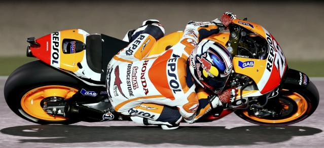 Honda MotoGP rider Dani Pedrosa of Spain races during a free practice session at the MotoGP World Championship at the Losail International circuit in Doha March 21, 2014. REUTERS/Fadi Al-Assaad (QATAR - Tags: SPORT MOTORSPORT)