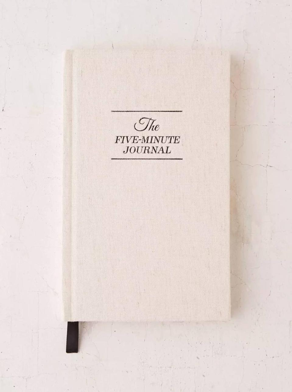 """While getting your diploma is a major life milestone, stress and confusion can strike as soon as graduation concludes. This Five-Minute Journal has positivity prompts and thoughtful tips that will help promote happiness and general well-being during this transitional time, while helping to push negative thoughts out and bring gratitude in. Shop more gratitude and manifestation journals we love <a href=""""https://www.glamour.com/gallery/gratitude-journals?mbid=synd_yahoo_rss"""" rel=""""nofollow noopener"""" target=""""_blank"""" data-ylk=""""slk:here"""" class=""""link rapid-noclick-resp"""">here</a>. $25, Urban Outfitters. <a href=""""https://www.urbanoutfitters.com/shop/the-five-minute-journal-by-intelligent-change?"""" rel=""""nofollow noopener"""" target=""""_blank"""" data-ylk=""""slk:Get it now!"""" class=""""link rapid-noclick-resp"""">Get it now!</a>"""