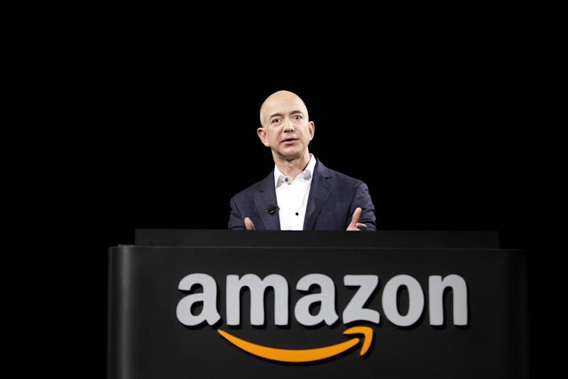 FILE-In this Thursday, Sept. 6, 2012, file photo, Jeff Bezos, CEO and founder of Amazon, speaks at the introduction of the new Amazon Kindle Fire HD and Kindle Paperwhite personal devices, in Santa Monica, Calif. Amazon reported third-quarter results below Wall Street's expectations on Thursday, Oct. 25, 2012, including a large loss that was weighed by its stake in its online deals service LivingSocial and continued investments in technology and distribution centers to grow its business.  (AP Photo/Reed Saxon)
