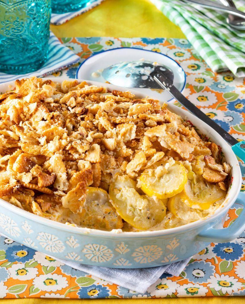 """<p>Similar to mac and cheese, this classic southern dish gets its flavor from the creamy cheese sauce. But if you ask us—it's the buttery cracker topping that makes it utterly divine! </p><p><a href=""""https://www.thepioneerwoman.com/food-cooking/recipes/a36700256/squash-casserole-recipe/"""" rel=""""nofollow noopener"""" target=""""_blank"""" data-ylk=""""slk:Get the recipe."""" class=""""link rapid-noclick-resp""""><strong>Get the recipe.</strong></a></p>"""