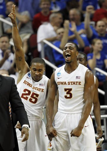 Iowa State forward Melvin Ejim (3) and guard Tyrus McGee (25) react after a 3-pointer against Connecticut in the first half of their NCAA tournament second-round college basketball game in Louisville, Ky., Thursday, March 15, 2012. (AP Photo/John Bazemore)