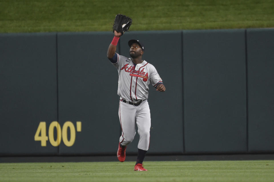 Atlanta Braves center fielder Abraham Almonte catches a fly ball hit by St. Louis Cardinals' Paul Goldschmidt during the ninth inning of a baseball game Tuesday, Aug. 3, 2021, in St. Louis. (AP Photo/Joe Puetz)