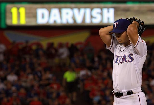 ARLINGTON, TX - APRIL 09: Yu Darvish #11 of the Texas Rangers throws against the Seattle Mariners at Rangers Ballpark in Arlington on April 9, 2012 in Arlington, Texas. (Photo by Ronald Martinez/Getty Images)